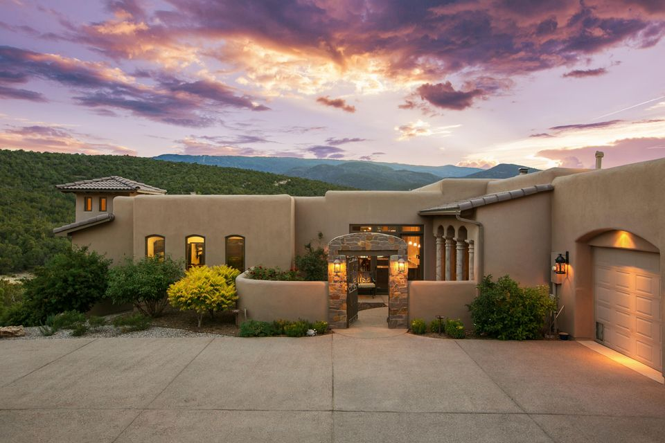 Exceptional and luxurious are just two words to define this custom ''resort like'' single-story San Pedro Creek Estates.  Situated on 10+ acres, this hill top paradise blanketed w/ Pinon trees. Majestic Sandia Mountain scenery with Ski Basin views.  Savor your morning sunrises & evening sunsets outside your sprawling covered patio featuring brick flooring, wood burning fireplace, motorized shades, and built-in grill w/ prep sink. The tranquil front courtyard invites you into the warm 7 welcoming great room w/ wood beam ceilings, custom stone stacked wood burning fireplace & picturesque views of the Sandia's through the Semco glass doors. Open gourmet kitchen will appeal to the novice cook or experienced chef. The kitchen features Thermador  SS appliances,Alder wood cabinets, a large island