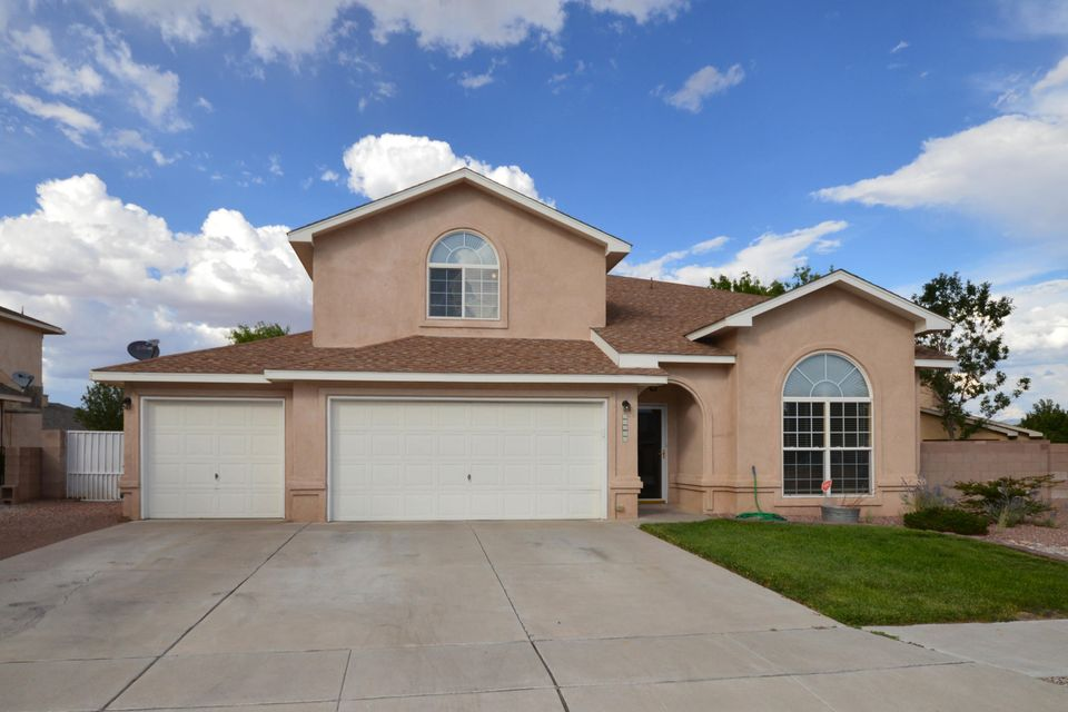 This hard to find 5 bedroom home has two spacious living areas including family room with wooding burning fireplace with log lighter. Kitchen has stainless appliance, including microwave and gas stove, large island/bar and pantry. Four bedrooms upstairs including spacious master suite with private balcony with mountain views, walkin closet and bath with dual sink vanity, garden tub ans separate shower. Fifth bedroom on main level with attached bath has Murphy bed, ideal for guests or in-laws. Additional features include 3 stage water filtration system and finished 3 car garage with epoxy coated floor. Home sits on a large lot with backyard access with concrete pad, ideal for RV, boat or trailer. Backyard has covered and open patio, gated dog run and storage building.