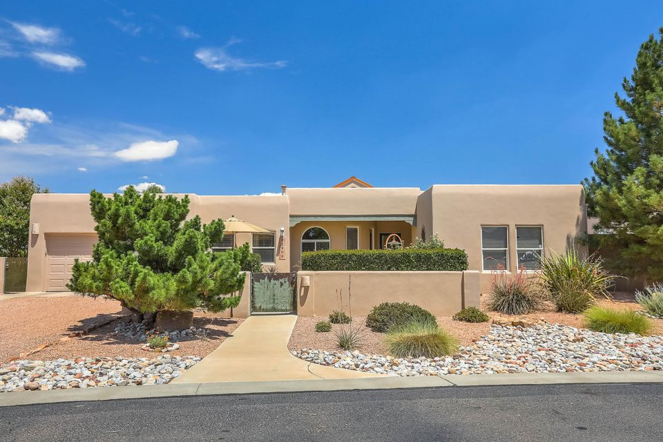 VIEWS! Enjoy the beautiful views from this well-placed home in the Gardens on the Rio Grande gated Subdivision.  Located in Old Town off of Mountain Road and Rio Grande near the Bosque. Enjoy the common area Greenbelts - Park-like areas maintained by the H.O.A.  Views from the living room, master bedroom and kitchen. OPEN, light bright functional floorplan with raised ceilings. $5K CARPET ALLOWANCE with acceptable offer.  3 full bedrooms. 2 bedrooms share a  jack n' jill bath between them. Radiant floor heating, Refrigerated air, 2.5 Car garage. Bring Fido! Matching Doggy Condo with AC is attached for your furry friends. House  floor plan attached. See attached photos, video and documents for more information.