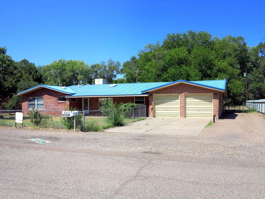 Great home situated in the heart of Bosque Farms! Sprawling ranch style home with a metal roof! Walk into an open floor plan featuring hardwood floors, and fresh paint!  The office has potential for a small room.  Backyard access, and a storage shed are a great start to making this yard your own.  Schedule a showing today!