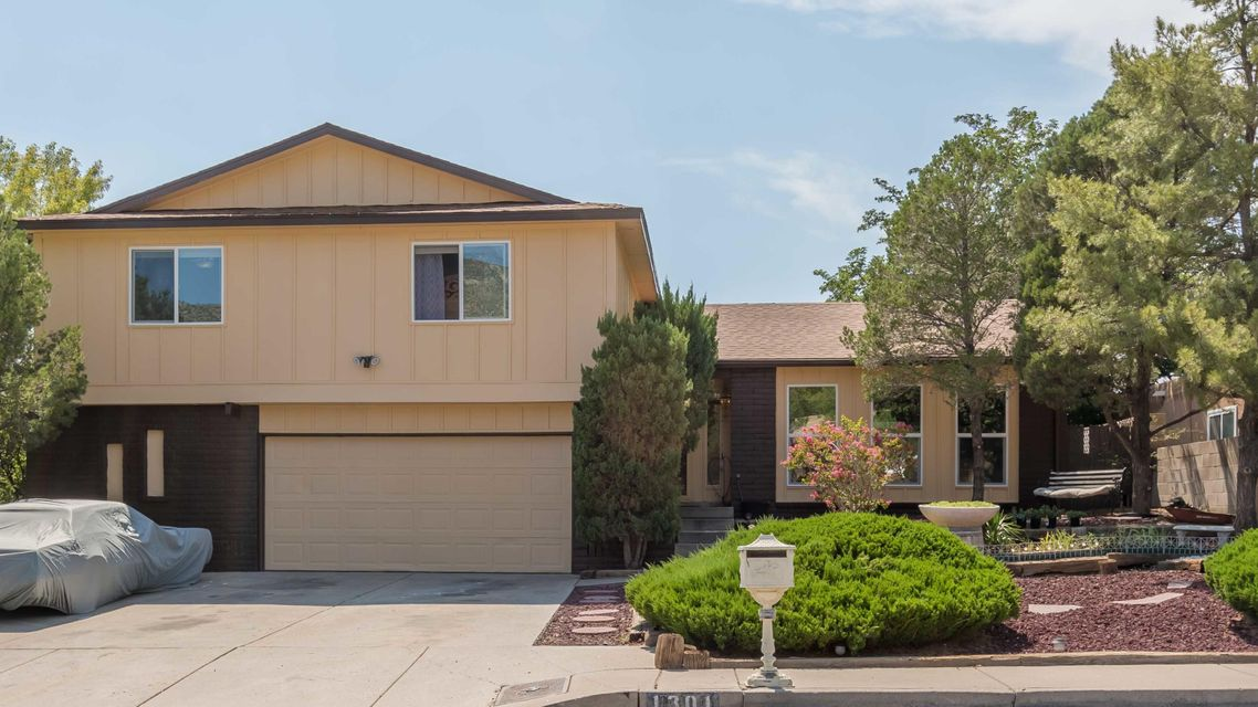 Beautiful home with lots of upgrades!  Newly installed windows, roof, carpet, hot water heater, and updated kitchen and baths!  Enjoy the outdoors with the lush landscaping and VIEWS!  Come see this one before it's gone!