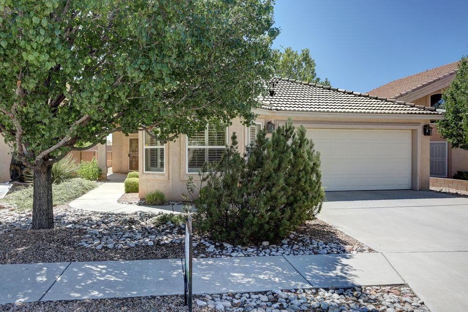 Delightful, bright single story home tucked away on a quiet street in the desirable Desert Ridge Trails neighborhood - close to shopping, restaurants and schools. Gorgous updated kitchen with flowing quartz countertops and glass tile backsplash. Open to the large great room with soaring vaulted ceilings, clerestory windows and gas log fireplace. Kitchen nook leads to the patio area that is perfect for entertaining, enjoying sunsets and even the Balloon Fiesta! 3 spacious bedrooms, one with beautiful views of the Sandia Mountains. Master suite with private walk-out to a covered patio. Master bathroom boasts a large soaking tub, separate shower and double sinks. Stay nice and cool with REFRIGERATED air, plus deluxe automated exterior shades. Lovely, low maintenance back landscaping.