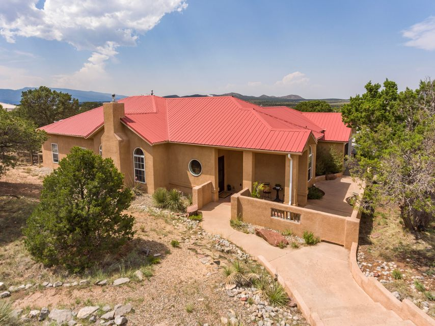 OPEN HOUSE 8/10 1-3PM, 8/11 12-2PM, 8/12 11-1PM. Hurry, this one won't last long! GREAT home for entertaining!!! This is what you've been looking for; a Beautiful Light Bright open-floor plan!  2 acres with great mountain views! Fully fenced and gated with a separate fenced dog yard. Property is on the Entranosa Water system. You can relax on the outdoor patio complete with a kiva fireplace. You will enjoy in the enclosed sunroom! Granite counter tops! One a dead end street with only a handful of neighbors.