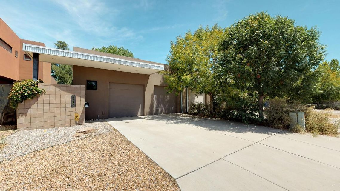 Gorgeous Modern Country Club area home! Space abounds in the open home w/ floor to ceiling windows and indoor-outdoor living space! Granite counter-tops, high ceilings, refrigerated air! 3 LARGE bedrooms with theatre room and office area! Master bedroom is located downstairs with large walk-in closet and direct access to the private back patio! Close to Downtown, Albuquerque Country Club, Kit Carson Park and much more!