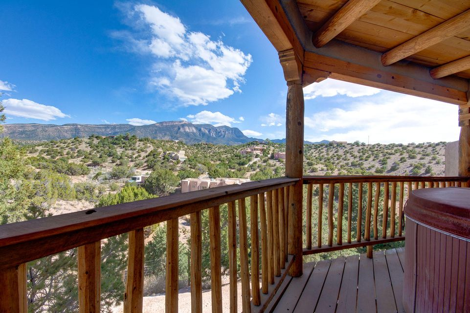 Location, Views & 15 years new in beautiful Placitas, where the wild horses roam,  hawks soar in gorgeous blue NM skies & just a short lovely drive into ABQ w/easy access to Santa Fe. Seller planned to make this a forever home with all the incredible improvements that will keep on giving for years to come. No propane, natural gas, solar panel free & clear that are creating energy year round, recent BAC roof with transferable warranty, new septic drainfield and filter in 2016, driveway to front door August 2018, tankless water heater, stucco & refrigerated air! There is so much here to appreciate...Perfectly located in the Rancho De Placitas subdivision and on Community Water.  What more could you want?  Call NOW for your private showing & allow us to help you make this your Dream Home!