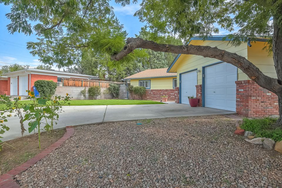 Great curb appeal.  Visit this move-in ready home  in the Sandia School district.  Three bedrooms  with lots of natural lighting, plus an office or craft room, 2 car garage, two living areas, and lovely backyard with open patio for entertaining.  You would love this home that is conveniently located to Uptown and I-40.  Come check it out!