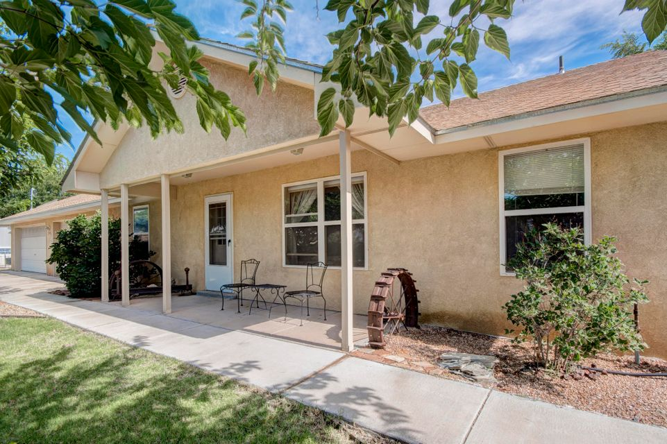 You'll love this NORTH VALLEY newer home at an affordable price in a fantastic location. Just a stone's-throw from restaurants and more along 4th Street and quick easy access to Paseo del Norte. This is a very practically designed custom home with a garage you won't believe!! (4 bays with 2 overhead doors - heated and cooled)  Large living room - Large Master - and RADIANT FLOORING throughout.  Minimally, yet tastefully, landscaped front and back for great greenery while providing low maintenance in a quiet neighborhood; with an alfalfa field adding a privacy buffer in back.  If you'd like move-in ready with an abundance of room for your toys and hobbies, this is the place!