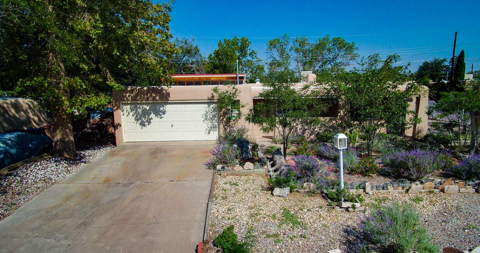Enjoy the convenient North East Heights location in the Snow Heights neighborhood including a large corner lot with lush landscaping and backyard access.  Views of the Sandias from the large Living Room window and the fireplace in the Great Room add the perfect touches for suburban living near the foothills.  Call for a private showing!