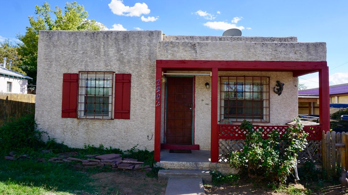 Great quaint home that is close to UNM and KAFB! Original Hardwood floors, newer updated double pane windows, updated refrigerated units in the home, one car garage with a carport and a built on utility shed that connects the garage and the house. Home is sold as is.* NEW ROOF WILL BE ADDED SOON *