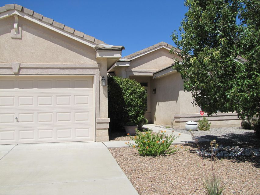 Lovely single story home in the enticing clean neighborhood of Vista Del Norte!  As you enter the custom made front door, you'll find it is blessed with refrigerated air, tile roof, alarm system, formal dining, two living areas, open great room with gas fireplace, entertaining eat-in kitchen with built in seating with storage below, butler pantry including wine cooler, plus large walk in pantry, gas range with microwave, breakfast bar, three bedrooms plus study/office with bookshelves, large master bedroom includes full bath with jetted garden tub, separate shower, huge walk in closet with mirror doors, laundry room with mud sink with built in cabinets, three car garage, manicured front yard and backyard~ perfect for any celebration !!  Backyard access for toys too!
