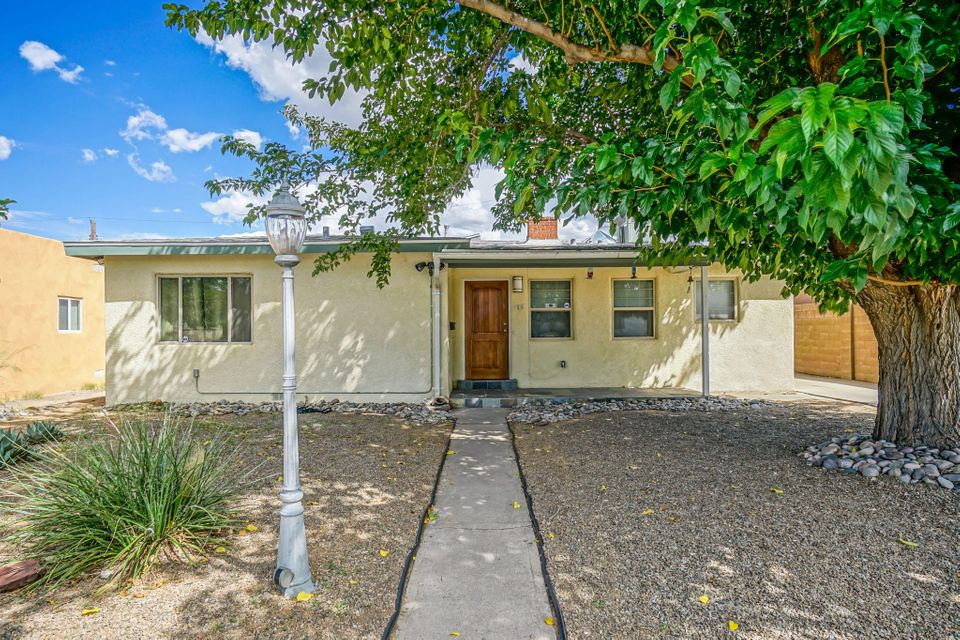 Excellent location!! Beautiful 3 bedroom, 2 bathroom home with hardwood floors, completely remodeled kitchen with stainless steel appliances. Master retreat or guest suite flooded with sunlight from massive french doors and South facing clerestory windows. MBR features a full bath and large over-sized closet. Vinyl windows. Washer and dryer convey with the purchase. Tons of storage space. Over-sized 1 car garage w/workshop. Private backyard w/brick patio. This beauty is just a short walk to Old Town Plaza, Tiguex Park, museums, restaurants, Lowe's Corner Market, the courthouse, Duran Pharmacy and the post office. Quick and easy access to downtown, farmers market, UNM, breweries and more!!  This one has it all in a walkable, friendly neighborhood. You must come see it to appreciate it