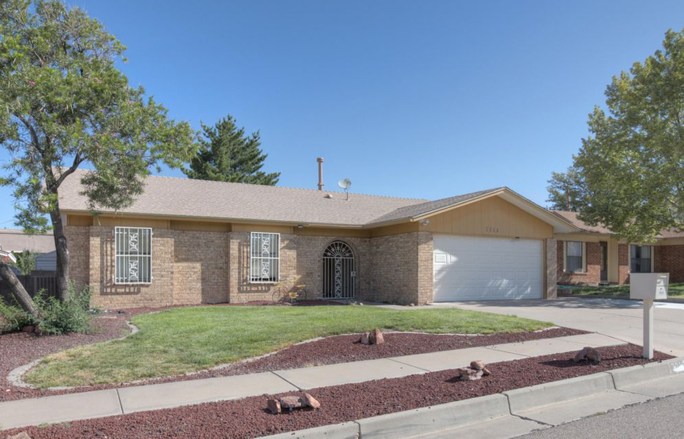 Pride of ownership really shows with this home that has been extensively updated.  Great location close to Paseo and just minutes to I-25, yet situated on a quiet dead end street.  Updates include a completely remodeled kitchen with custom cabinets and granite counters, recent roof, refrigerated air/heat combo.  Wonderful, lush backyard with garden area and small pond /waterfall, Large master suite,  more special touches throughout!