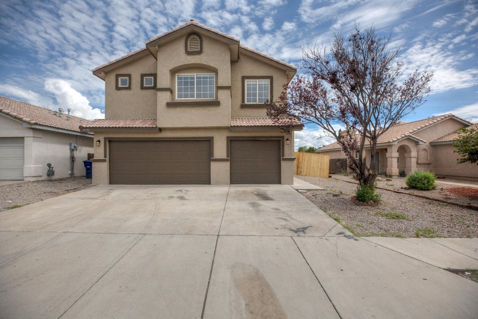 Beautifully remodeled 4 bed 3 bath 3 car garage home in the sought after cottonwood heights area! This home will not disappoint! A few of the stunning updates this home has are: new 12x24 tile floors, new paint throughout, new carpet, solid brand cabinetry, quartz counter tops in kitchen, granite in baths, new stainless steel appliances, a pattern backsplash that completes the kitchen, large island for plenty of prep area, refrigerated air (a must), a roomy 3 car garage, upstairs patio perfect for Balloon fiesta time, new 6' high wood panel fenced backyard, all new light fixtures, custom built out closets, an amazing master bathroom with large shower and double sinks, can lighting, covered back patio.  This home has it all! You will see and feel the difference when you're in this home.