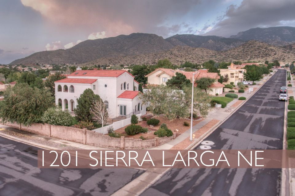 Vista del Mundo, Unique Mediterranean style home with Amazing Mountain Views. 4 BR 2+1/2 BA. Open & roomy. Large eat-in Kitchen with island & granite counter & all appliances including a wine cooler. Vaulted ceilings in main living area & foyer. Large Master Suite with city and mountain views from private wrap-around deck. His & hers bathroom with mountain views from the spa tub, plus a double shower. Separate closets, including spacious walk-in Closet. One bedroom with built in cabinetry for an Office. Over-sized 3 car garage with built-in workshop space. Separate Laundry Room. Extra-large corner lot with rose bushes, fruit trees & lawn with auto-sprinklers in walled backyard. Lovely xeriscaped front. Access to Embudo Hills Open Space nature trails & bike trail just across the street.