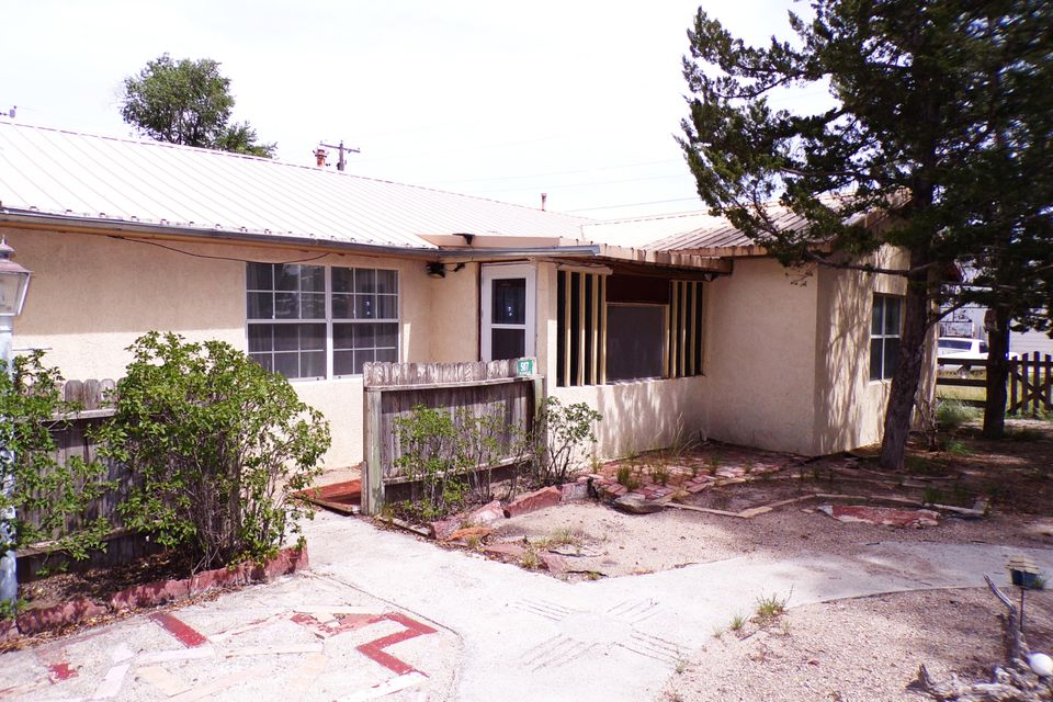 This home in quaint Estancia, New Mexico has 3 bedrooms and 2 baths and is a short walk to Arthur Lake which is a part of the Estancia City Park.  This is an older home with beautiful hardwood floors, a large dining room and a root cellar just off the kitchen.  There is an enclosed back porch area and a garden shed in the fully fenced backyard. This is small town America with a lifestyle that is easy going and rural.  Albuquerque and Santa Fe are about an hour away.