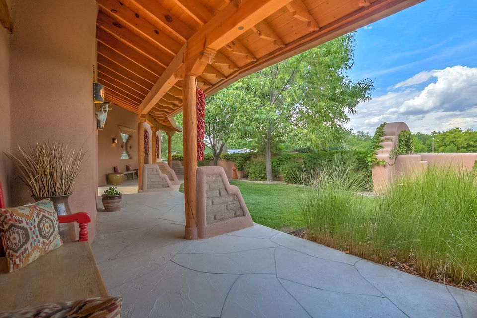 Exceptional equestrian property on a private cul de sac w/ access to the Paseo del Bosque trail. Ride your horses out the gate. This exquisite custom home is filled w/ beautifully crafted finishes rarely found in a newer home. Custom ceilings w/ vigas, latillas and a barrel vault. There are two incredible master suites, one on the main level and another upstairs with a private deck with stunning views of the Sandias. The lower level features an office or bedroom adjacent to a 3/4 bath. There is an attached guest suite w/ a private entrance, deck & kitchenette. Five fireplaces, a chef's dream kitchen, a grand entry & great room, a tranquil family room, library/music room, sunroom, casual & formal dining. The exterior features courtyards, covered portals & all weather gazebo & hot tub.