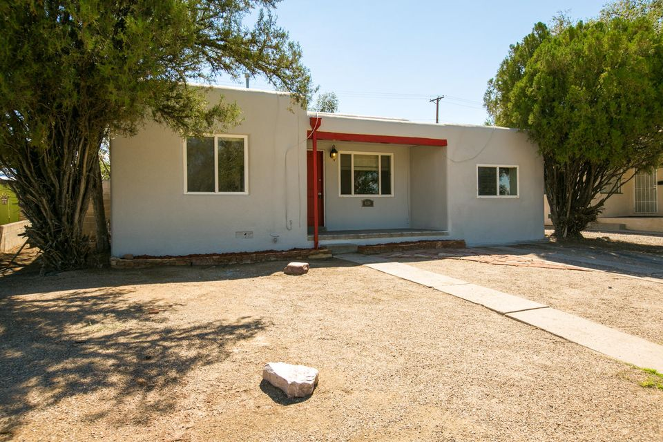 What a deal in Ridgecrest!  Hardwood And Tile throughout. Kitchen and Bath were remodeled with Stylish, Upgraded, Decorator Fixtures, Cabinets, Counters and Floors. Large Bonus Room(Studio/Office). Charming Fireplace, Coved Ceiling and Arched Doorways. Windows (Thermal) and Stucco were done then too. Off-street Parking. Private Back Yard with lots of possibilities. Across from Ross Park. Easy commute to KAFB, UNM and VA Hospital. Would make nice rental property for investors or AirBnB hosts!