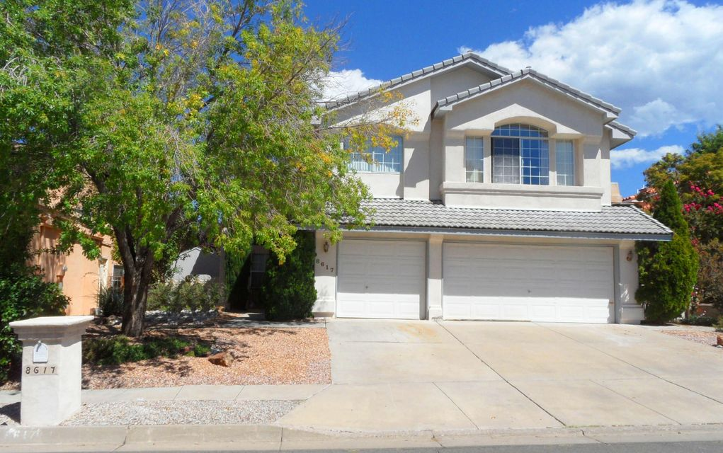 4/5 bedroom located in highly desirable Vineyard Estates!  Walk to Desert Ridge mid-school in just minutes.  La Cueva school district.  Dramatic Foyer with cathedral ceiling welcomes you into formal Living & Dining rooms.  Open floorplan, Kitchen open to Family room w/cozy gas log fireplace.  Tastefully remodeled Kitchen with granite counters, ample cabinet space, cook top & bar w/extra seating.  Spacious Master suite featuring private balcony, walk in closet w/bonus room, dual sinks,  garden tub, separate shower.  Extra large 19x10 upstairs bedroom could be second Master or media room.  Lush & lovely backyard w/raised garden space & timed sprinklers.  Three car garage w/double doors & storage space.  Great location, close to schools, Vineyard park, shopping, dining and Tanoan golf cours