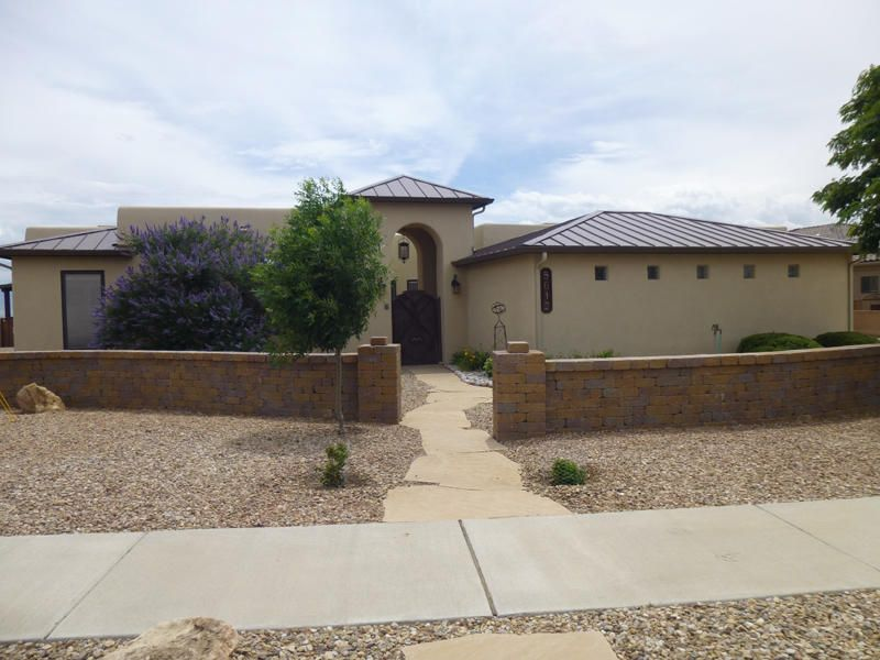 Enjoy a panoramic view of the Sangre de Cristos, Jemez, Sandias, & south to the Manzanos. Perched on the edge of the Petroglyph Natl Monument Escarpment the view is unobstructed & showcases the mountains & city. This beautiful home features mature landscaping & gated entry w/ courtyard. 13 ft ceiling with vigas/latillas in the Great Room; eat-in kitchen w/new frig & range, massive island, granite countertops & ample cabinet space plus adjacent generously-sized bonus room. Two master suites one with attached sitting room. 1 car + 2 car garages w/ work bench & storage cabinets. Radiant heat (13 zones); recirculating hot water; & water softener/RO water. Swim spa & hot tub plus east-facing covered back patio offer the ultimate in capturing a life of relaxation & sophistication.