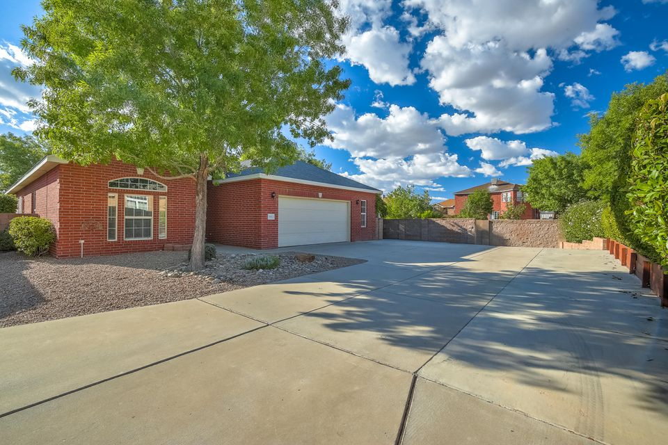 What a gem in popular Quintessence, a one story brick on a premium cul-de-sac lot w/views of Sandias. Lovely 3 bedroom home offers a split floorpan, large family room w/wood burning fireplace & picture windows to enjoy the lovely park like landscaping, bay windows to view the gorgeous mountains, formal living/dining rooms, kitchen w/nook, island, reverse osmosis, desk area, pantry, open to family room. Owner's suite also w/bay window, two walk-in closets, jetted tub, shower & double sinks. Secondary rooms freshly painted (9/18) & new carpet (9/18). Storage galore in the 2 1/2 car garage - room for workshop. Roof new in 2017 w/transferable warranty, evaporative cooler new in 2017, new disposal (9/2018), chair rails, patios....