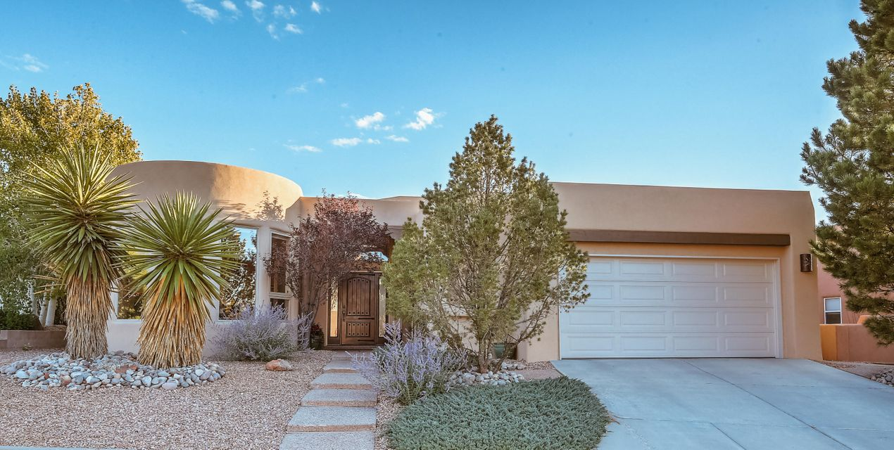 This One of a Kind Custom home has Breathtaking views of the Sandias from the Breakfast Nook! Close to shopping and schools! Passive solar sunroom. Recent updates include Carpet, ThermaTru entry door, Dryvit synthetic stucco, Silicone roof by Roofing USA, KitchenAid kitchen and dry bar refrigerators, HVAC vent covers and smoke detectors, two 12' Mastercool coolers, outside Gazebo, and New landscaping updates!Massive Vigas and Soaring ceilings compliment the sunken Great Room with built in entertainment area. Open and Bright with eleven Skylights and Clarestory windows. Check out the large Gourmet Kitchen with Granite Transformations and open bar stool area, Dry bar in the  Sunroom, Kohler Ultra in hall and master, 2x6 construction, oversized 2 1/2 car garage  and Much More!