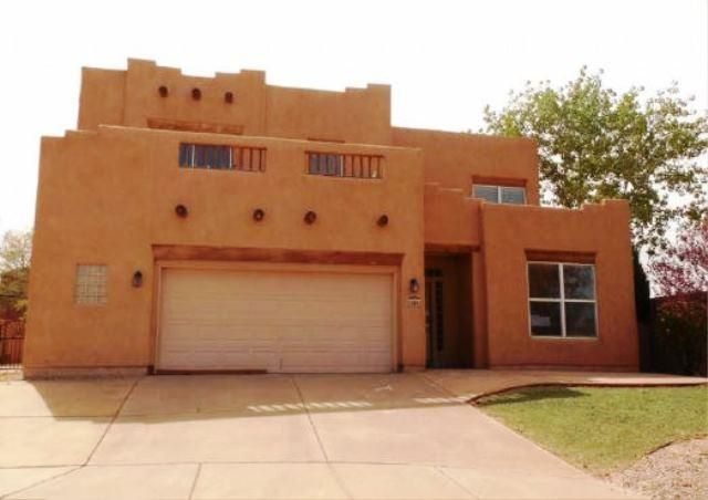 Gorgeous Pueblo style 2-story home on a large lot. The property features 5 bedrooms, 3 baths, a large kitchen with center island that opens to an expansive living room with wood beam ceilings and a corner fireplace. Large master also features a cozy corner fireplace. Nice sized backyard has plenty of room todesign your outdoor oasis. Don't delay!
