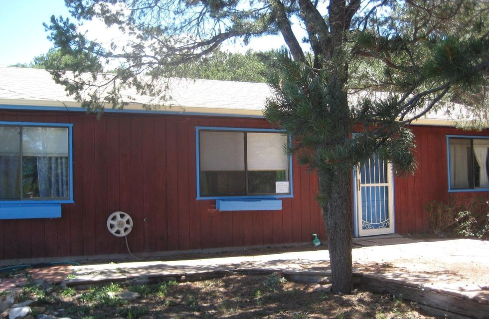 Located in the Sandia Knolls, this Tranquil & Quite charming home is nestled in the pines overlooking the Sandias. Open floorplan,  3 Bedrooms, 1.75 Baths, 1239 square feet. Community water. Quick access to the ski area & to hiking trails in the Cibola Nat'l Forest. Peace, Quiet & Beauty. Not to be Missed!