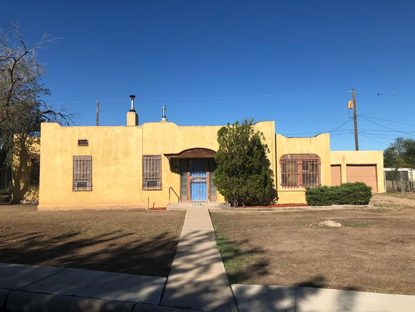 Attention flippers, Contractors and handy persons. Large double lot .23 acre lot in downtown! spanish mission House built in 1936. Could be renovated or razed. City has approved splitting double lot in order to build two new construction houses. Sold ''AS IS''Length is 120' width is 105'