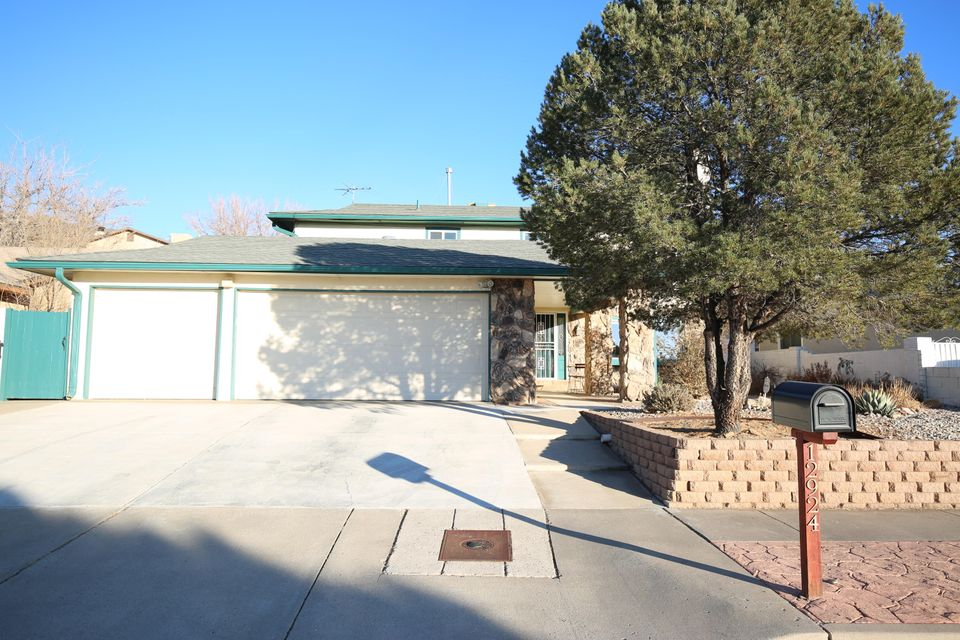 Meticulously maintained and updated two-story home near Tramway and Indian School with easy access to I-40. Highly sought after NE Albuquerque Location. This home boasts 2 Living Areas, formal dining room, 2 fireplaces, 4 Bedrooms, 2.5 Bath, 3 Car Garage. The Huge Master Bedroom features 2 walk-in closets, dual vanities and a fireplace. Kitchen opens to Family Room with built in bookcase & dry bar, entertainment alcove with space for mounting a 65'' TV, wired with JBL 5.1 speakers. Beautiful Hickory Kitchen cabinets, Stainless appliances and so much more! Breakfast nook overlooking Family Room has atrium doors that open to covered back patio & beautifully landscaped private yard for entertaining. Make an appointment and see it today, it may not be here tomorrow!