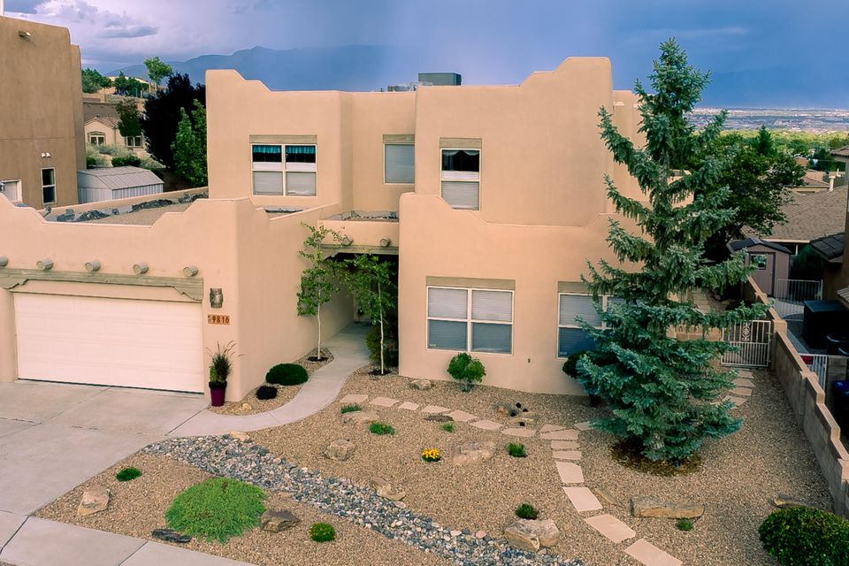 This home has all you have been looking for and more! Lovingly cared for home with all the bells and whistles...Open and bright design with master suite downstairs, 3 car oversized tandem garage-perfect for shop or extra cars, granite counters, stainless steel appliances, raised ceilings with vigas, refrigerated air, recirc pump for instant hot water, lovely city/mtn views from deck at media/gathering room, private wonderfully manicured backyard w/water feature, oversized laundry w/sink, walk-in closets and much more. AC less than 4y old, hot water heater 1 y old & all brand new carpet just replaced 2 months ago.