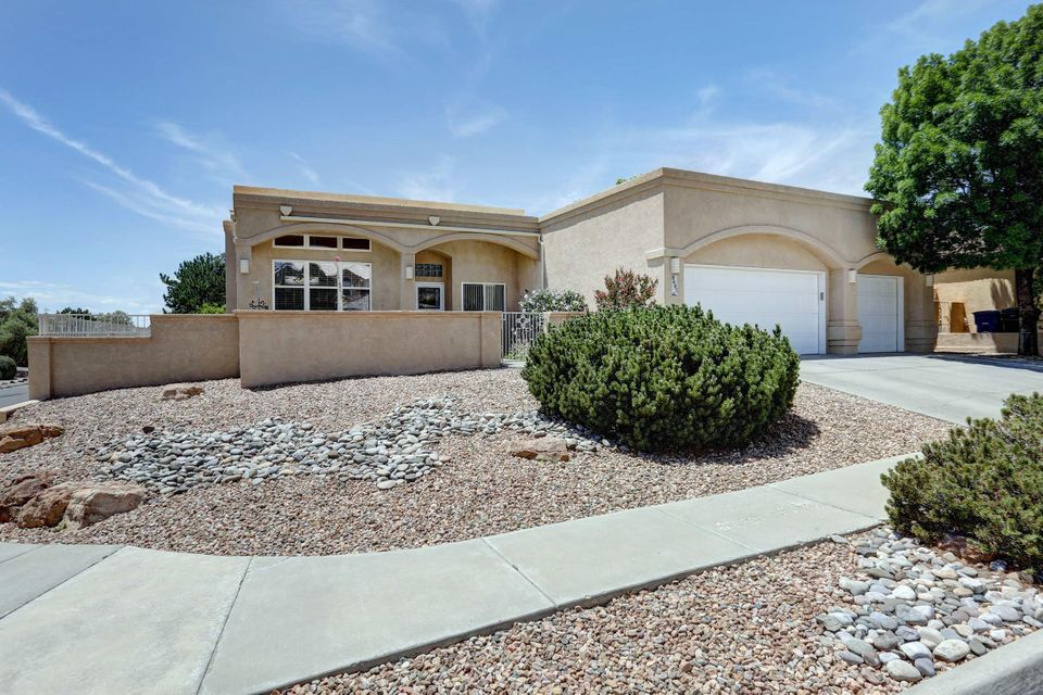 Wonderful single story home with 3 car garage in desirable Double Eagle, Desert Ridge and La Cueva High School boundary. Open concept floorplan with architectural accents featuring volume ceilings, curved walls, arched openings and art niches. Kitchen updated with new cabinetry, granite counters and stainless steel appliances.  Large Eating Area and walk-in pantry too. The Family Room has a focal point gas log fireplace. The Kitchen, Living Room, Hallway, Baths, Bedroom #4 & Laundry Room have over-sized, neutral tiled flooring. Separate Dining Room. 4 Bedrooms, one with a curved wall. So much natural light, there's even a skylight in the Laundry Room! Tons of closet space too. Spacious Master Bedroom with full, private Bathroom and walk-in closet. Covered backyard patio. Welcome Home!