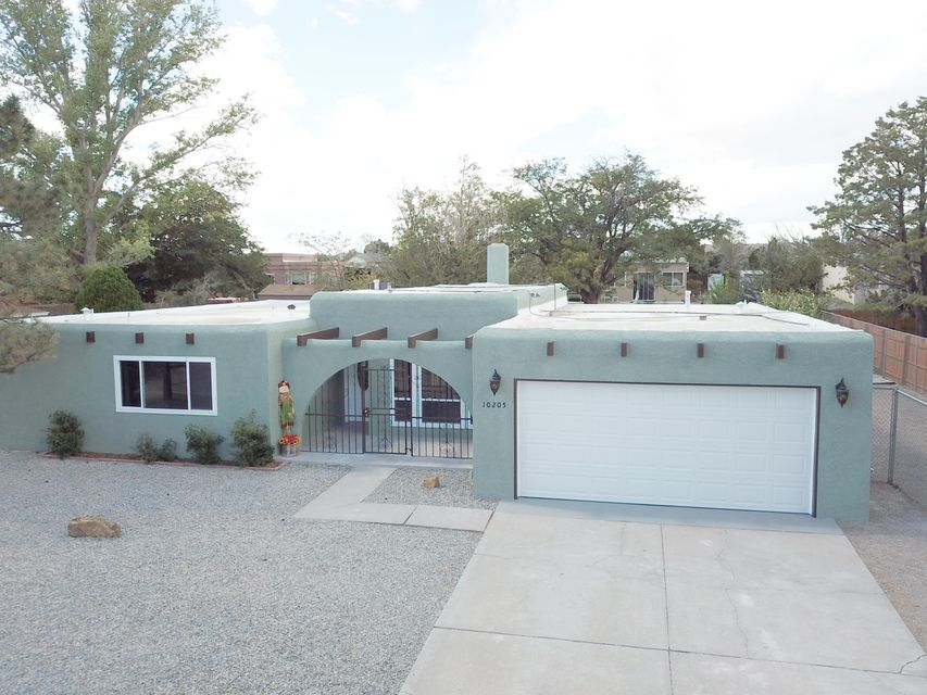 Extremely hard to find 1 story with 4 large  bedrooms, two living areas, BONUS ROOM, and fully remodeled.  Major ticket items also updated: windows, roof, refrig air, furnace, master bath, kitchen, garage door, int/ext paint, all floors, landscaping, etc, PLUS oversized garage and true RV /backyard access.  Very open floor plan and lots of extra room.  Great neighbors and neighborhood with walking distance to park, churches, and schools.  Perfect location also close to major new businesses in Rio Rancho.  We have seen the rest, this one is the best!