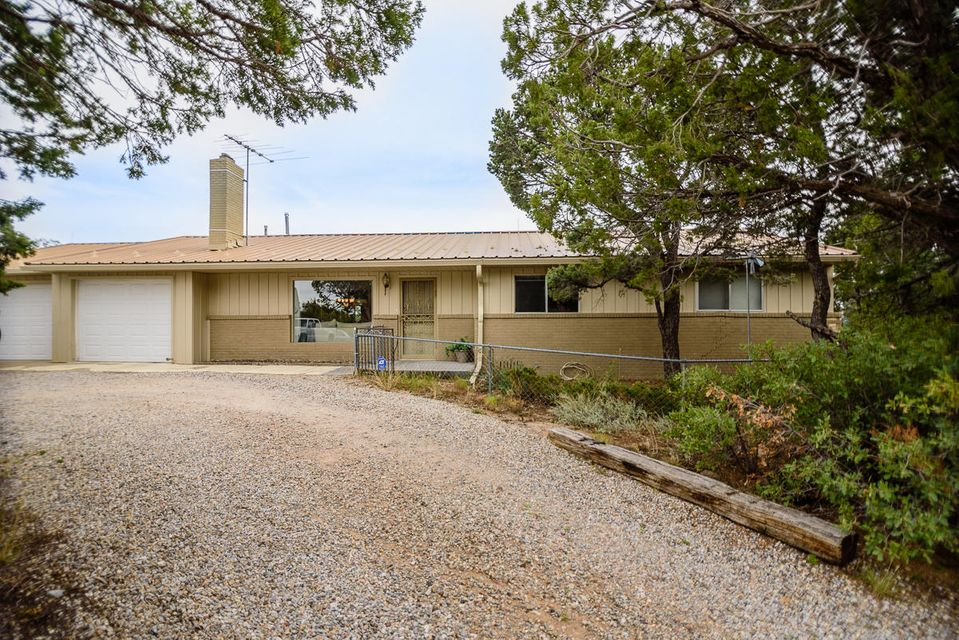 Welcome to this gem in Sierra Vista Estates !  Enjoy gorgeous views while sitting in your sunroom with a warm, cozy fire.  This original three bedroom home was converted to a two bedroom to allow for an oversized master suite with fireplace. The large open living room with a 3rd fireplace allows for plenty of room to entertain, open to the dining area and through to the sunroom and back patio.  You will be amazed and excited when you see the back of the home, just waiting for your own ideas and design.  And the views....well, you need to come and see for yourself!