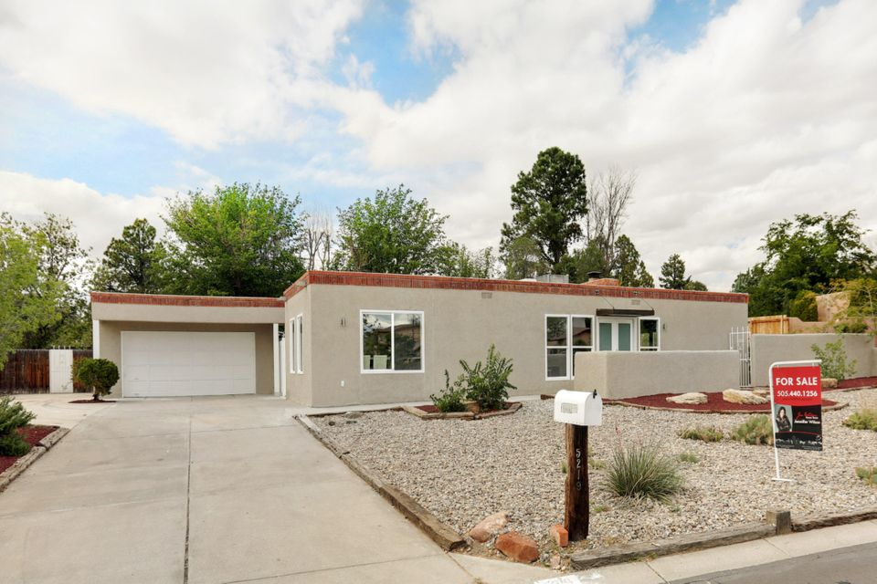 Paradise Hills Golf Course Territorial home, tastefully updated with a contemporary flair. Double door entry welcomes you into an open, bright, usable floor plan. Upgraded kitchen with new cabinets, double pantries, ample counter space with waterfalled quartz counters, & stacked quartz backsplash.  Dining with mountain views.  2 way fireplace flows from kitchen to living room. Living room has french doors that open to side courtyard.  Master suite with walk in closet, bathroom with floating sink & barn door entry.  Master bedroom has it's own side patio.  All bedrooms have ceiling fans & walk in closets with auto lights.  Detached garage has additional storage, & covered walkway into side door of house.  New refrigerated ac/heat combo unit. TPO membrane roof & thermal windows on 1/3 acre.