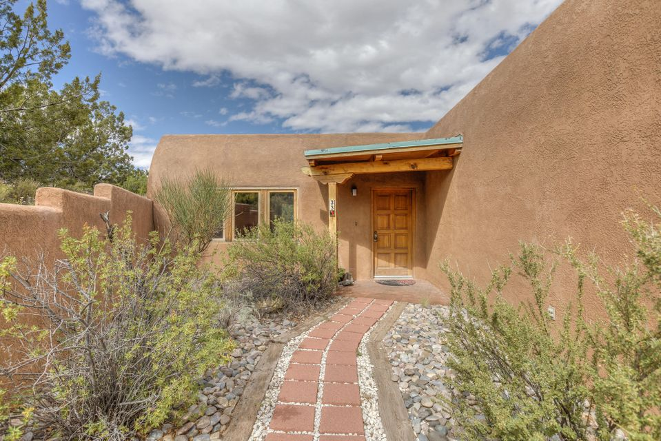 Beautiful Taggart Adobe with breathtaking views of the mesas from the living room, dining room, and huge covered back patio! Very functional open floor plan with lots of natural light. Tongue & Groove ceilings and brick flooring throughout. Easy care landscaping and lots of privacy with almost 1.5 acres all to yourself! Easy access to I-25 makes this the perfect home for those that want to be just outside the City.