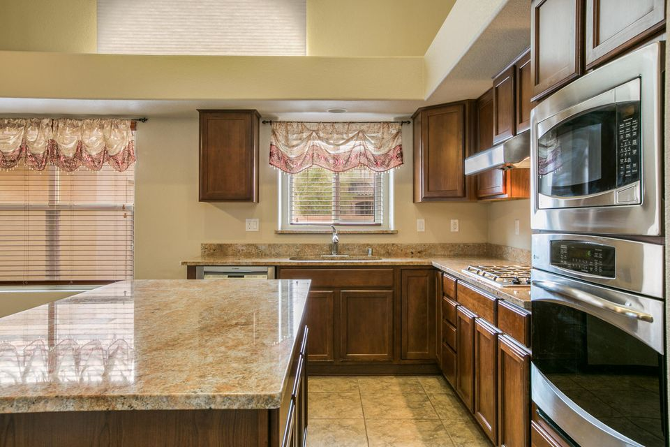 Seller offering $5K toward buyer closing costs and pre-paid items w/ acceptable offer! Engineered wood and tile floors throughout main areas and master bed/bath. Dream kitchen with granite countertops, center island, large pantry, ample cabinet space and stainless steel appliances. All appliances stay! Open floor plan with formal living, dining and generous office in front.  Family room with cozy fireplace open to kitchen and breakfast area.  Large master bedroom and easy access en-suite bathroom with roll or step in shower.  14 OWNED solar panels provide great energy efficiency.  Beautiful backyard with putting green, and expansive patio. All this with back yard access and custom designed outdoor storage/man cave/she cave/play house!
