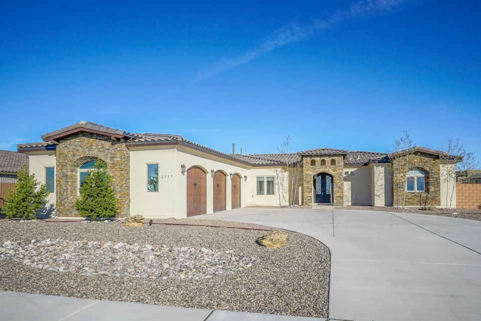 Newly built custom home w/ 2x6 construction in the heart of Petroglyph Estates. This beautiful home features exposed decorative trusses, custom high-end cabinetry, granite counter tops, dry bar, farm sink, stainless steel appliances including smart fridge, kitchen island w/ bench seating & exterior privacy glass tint. Open living area w/ fireplace & custom built-in entertainment center. Backyard includes access for RV/Trailer & natural gas extension for future outdoor kitchen. Master suite includes spa like pebble floor shower, his & her vanities & walk-in closets w/ built-in shelving. Additional features include roughed in audio speaker system in MBR, LR & outdoor porch, custom window seating & shelving in spare rooms, over sized laundry/craft room, playroom & workout area & so much mor