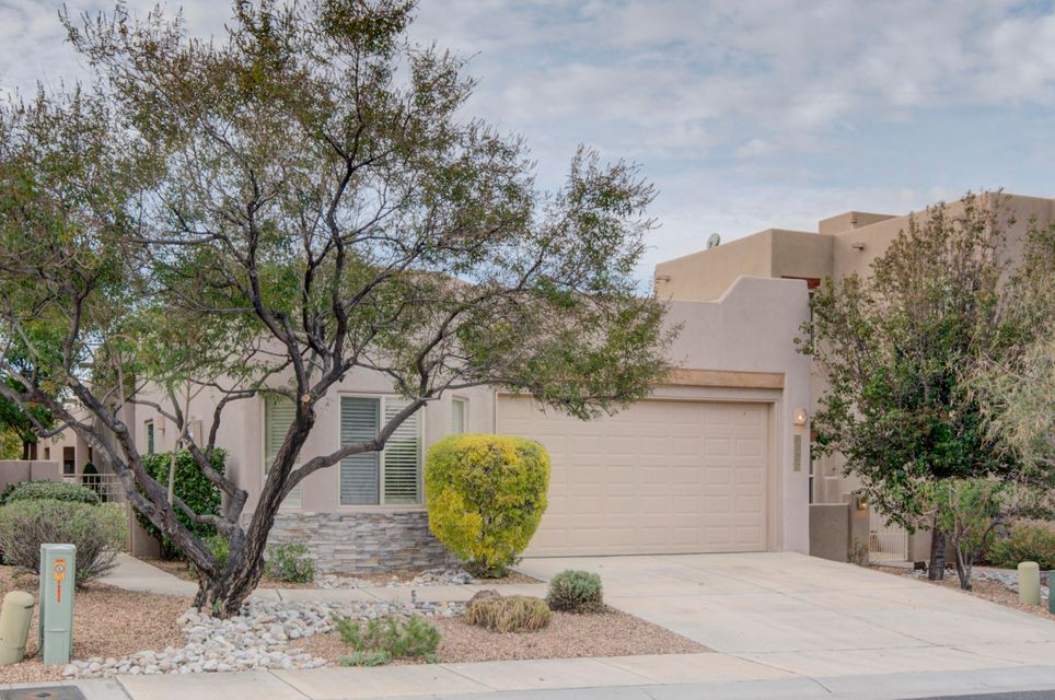 Stunning home in sought after gated community of Desert Ridge Place. Pride of ownership show here! Gorgeous home boasts high ceilings, granite in kitchen, ceiling fans, nice sized laundry room, nichos and skylights throughout. New flooring throughout, refrigerated air. Gas fireplace in the great room which leads out to the fully landscaped rear yard with covered patio and views.