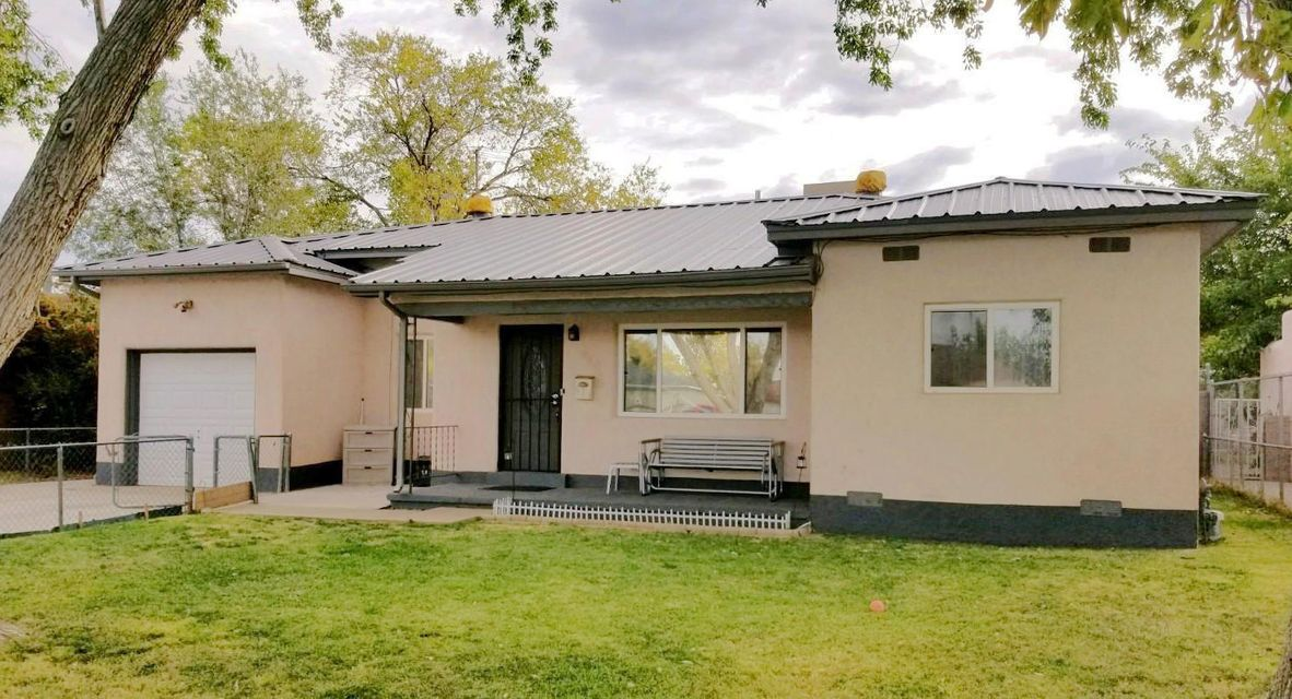 Check out this Northern New Mexico Style Ranch Home. A Metal Hip Roof gives the Home the Charming Norteno Style. This home is well cared for and has been updated! The Eat in kitchen has been remodeled with Sandstone Counter Tops and Cherry wood Cabinets. Bathrooms recently upgraded. Furnace, Water Heater, Roof, Electric Panel, and cooler have all been recently updated. The Polished hardwood floors adds the character that makes these well built 1950's homes so desirable. Schedule your appointment today!