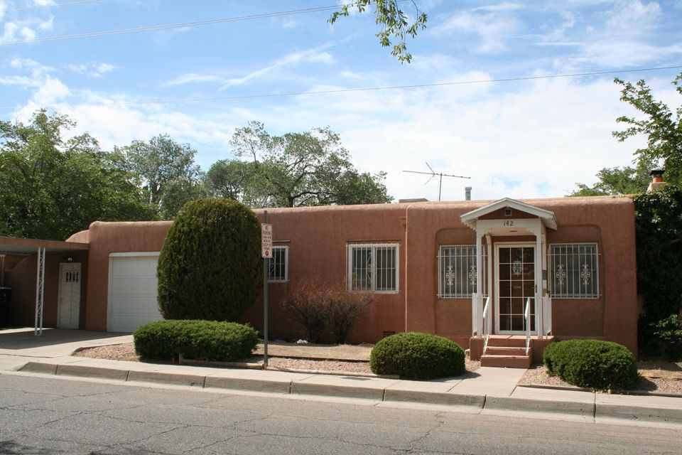 Gleaming hardwood floors, wood framed windows, interior fairly sparkles!  Just a stone's throw from UNM and Knob Hill. Private backyard with storage.  Bonus bath combined with service room.  Lightly lived in for the past 50 years+.  Yard could use some imagination, but other then that this home is ready for your buyer!