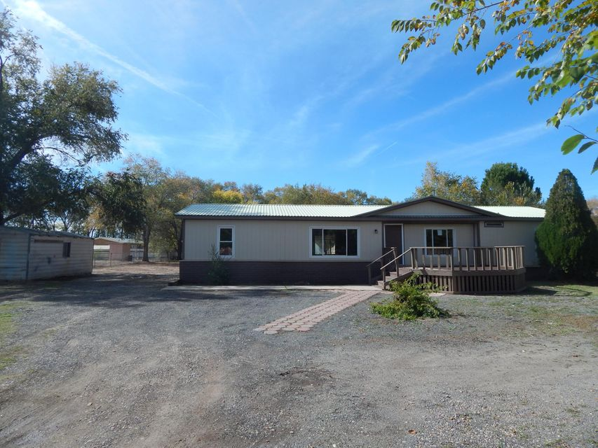 Great location in Peralta!  Established neighborhood with lovely 3 bedroom, 2 full bath home  on large .56 acre corner lot.  This home has been updated with fresh paint, new flooring throughout and  updated bath fixtures.  Relax and enjoy cozy nights by the fireplace in the huge family room.  Master Suite has large walk-in closet and gorgeous bath with double sink vanity, solid surface counter tops and spa tub.  Enjoy cooking in the gourmet kitchen with lots of cabinetry, granite counter tops, and breakfast bar.  Natural gas and city sewer.  Completely fenced and has large storage building.  Easy access to I-25 and minutes to Albuquerque.  Close to all City conveniences.