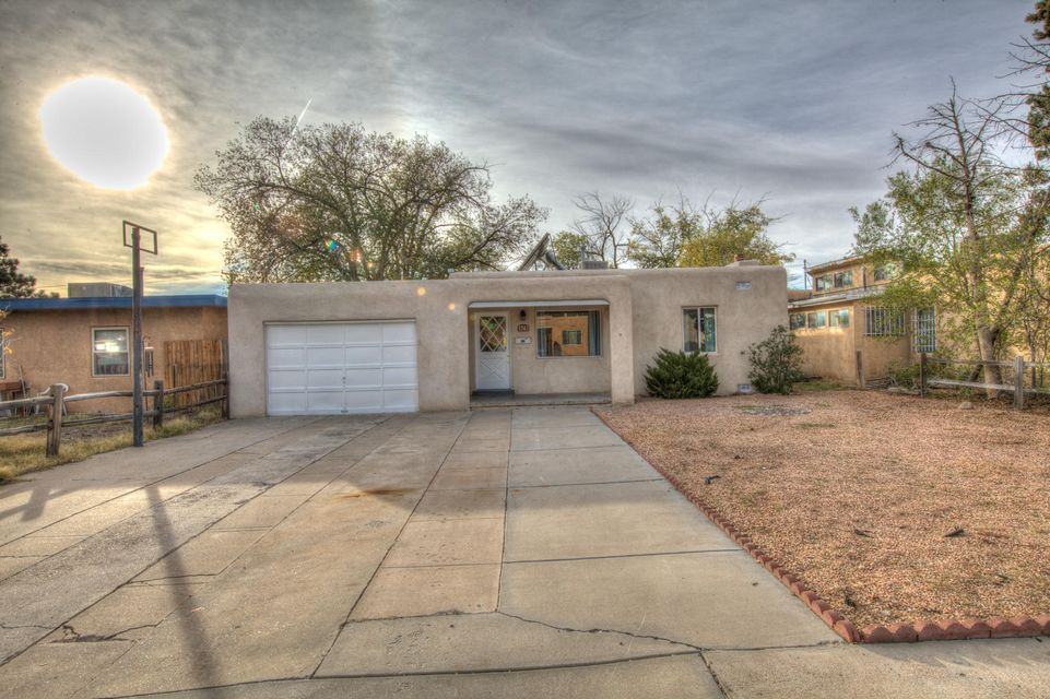 Beautiful remodeled home in desirable UNM location. Enjoy the fresh updates including new flooring, fresh paint new kitchen with new gas cook stove, Dishwasher granite counter tops and baths. Open light and bright flowing floor plan. Home has 2 living areas. Big lot. 2 car garage.