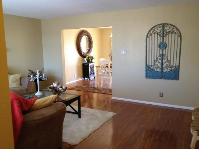 ** Open House Saturday 11/17 & Sunday 11/18 12:00 to 3:00 both days** This great four bedroom house in the heart of the northeast heights is looking for a new owner. Close to shopping, schools, parks and so much more. Nice layout with two living rooms one of which has a wood burning fireplace. Front living room and dining room have wood flooring.  All appliances stay with the home including washer and dryer. Bedrooms, hallway have original built-ins for lots of storage. Nice size backyard that has a block wall all the way around it.