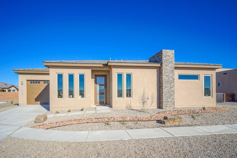 Located in the heart of the quickly growing Petroglyph Estates, this is the newest build by Rhett Ashley Homes.  This 3 Bedroom two bath home is full of upgraded features.  Wood like tile, stainless steel appliances, quartz counter tops high ceilings, perfectly placed sky lights, 8 foot doors throughout, pella low E windows, and a NM Green Build Silver rating are just a few of these features.  The oversized two car garage even has room for a workshop. MOVE IN READY!