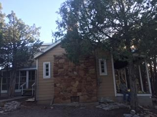 Last .10 (tenth) of a mile rugged, but so worth it. Tranquil - Private - Secluded in your own Slice of heaven where no one can find you.  Home surrounded by trees in peaceful Manzano Springs.  Rustic home/cabin Selling 'as is'.  Great for Second home.