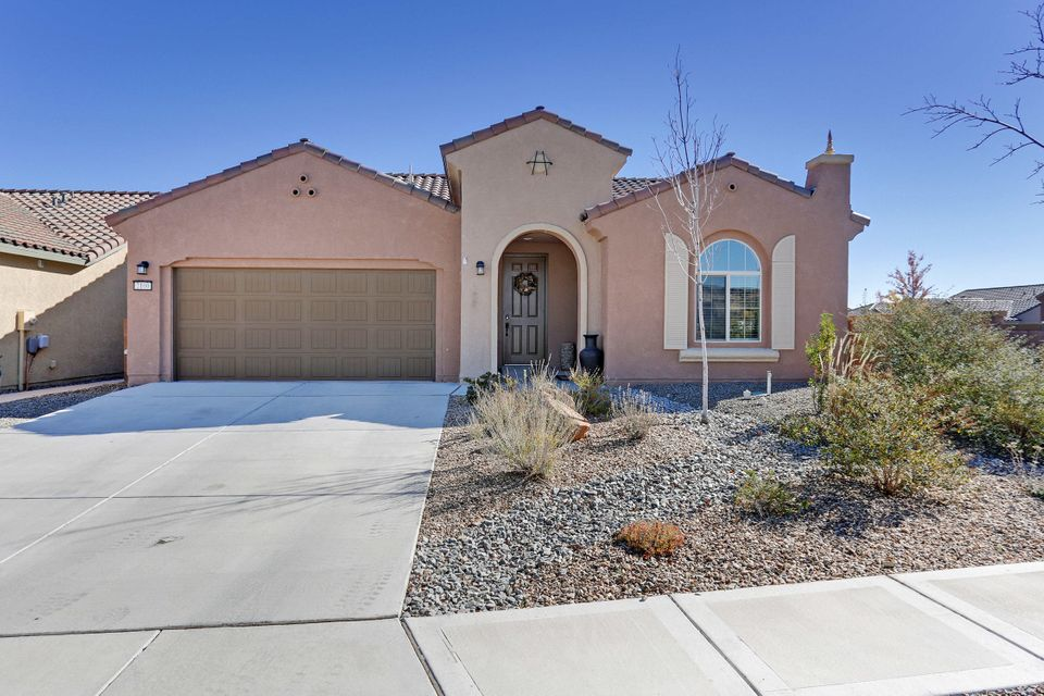 Why wait to build a home when this beautiful home is MOVE IN READY. It has the window treatments, landscaping and ready for new owners. Handicap accessible and all on one level. The kitchen is open to the MLA and the dining room. The master bath has a large shower with a seat. Enjoy the lights of Albuquerque while you sit by the warm and cozy gas log fireplace. This home has many extras and is READY FOR YOU. Home is on a corner lot with a oversized two car garage. park across the street with putting greens. CLUB HOUSE with POOL and many amenities.  Call to see it TODAY!!!