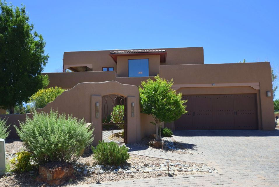 Exceptional Style and Design! Courtyard Entry leads to Foyer w Sweeping Stair Case, Custom Railing, Marble plaster, well appointed Chefs Kitchen w Jen Air Bronze Appliance package. Double oven, gas range, DW, Custom Cabinets, Granite Counter tops, huge island. Walk in pantry wet bar. Family room has raised Beam ceilings,separate cozy LR w Kiva style frpl & wood floors. Downstairs Mastersuite has lg walk in closet designed by Calif Closets.Upstairs Mst suite perfect for extended family or guests. Light & Bright loft w access to office & wrap around balcony. Unobstructed Mountain Views. Upgrades include Pella Wood Windows w blt-in blinds, tiles & wood floors, Custom doors & cabinets, surround sound. 2 HVAC units. Finished garage xtra, storage. Desirable gated community.