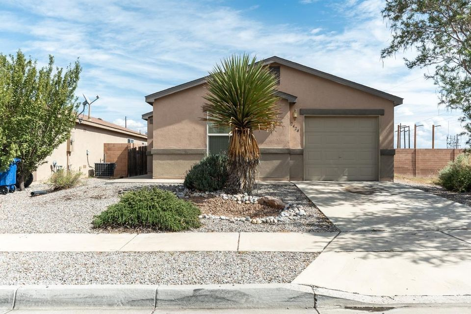 Super cute home with new paint and flooring! Nice layout with 2 living spaces - one in the front and one in the back. Low maintenance yard and no neighbors behind you!