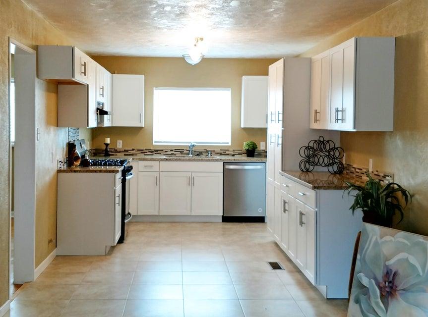 Feels like a brand new home and wait until you see the KITCHEN! NEW: Kitchen cabinets with granite and under mount sink, bathroom vanity, appliances, doors, door hardware, garage door with opener, TPO ROOF, STUCCO, windows, tile, plumbing fixtures, lighting fixtures, HOT WATER heater, electrical service upgrade and paint. Beautiful original HARD WOOD FLOORS. HUGE laundry/mud room!