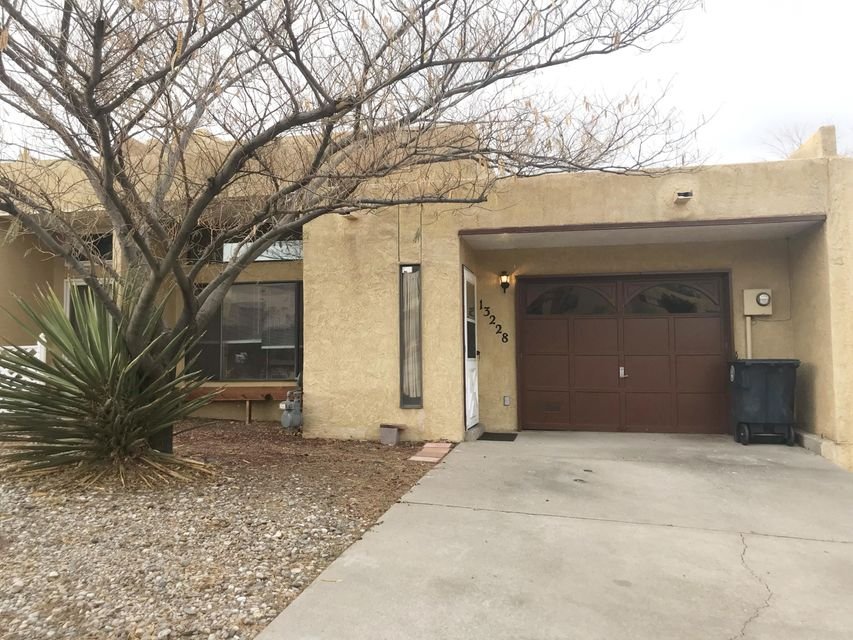 *OPEN HOUSE SAT 12/8 11AM to 2PM* No HOA! Super cute townhome in a great location has an open living room/dining room with a high vaulted ceiling, gas log fireplace, breakfast bar, laminate flooring, jetted tub in hall bath. Spacious master bedroom has a cozy corner fireplace, double closets, and access to backyard patio.